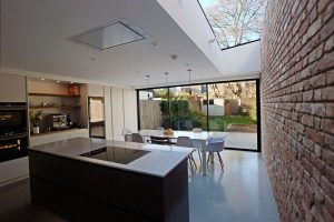 Concrete floor brick wall kitchen
